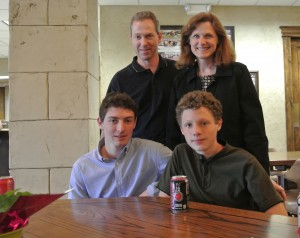 Collin Urquhart, 2013 scholarship recipient, with his family.